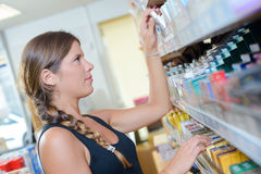 Woman picking product from shelf royalty free stock photos