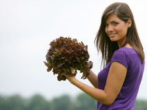 Woman picking a red salad Royalty Free Stock Images
