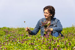 Woman picking spring flowers Stock Photography