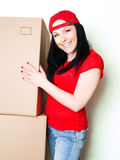Woman picking up boxes while working Royalty Free Stock Image