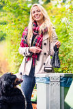 Woman is picking up dog poo putting it in dustbin Stock Photography
