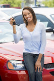 Woman picking up new car