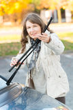 Woman picking up windscreen wiper Stock Images