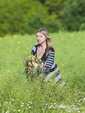 Woman Picking Wild Flowers on the Meadow Stock Image