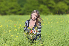 Woman Picking Wild Flowers on the Meadow Stock Photo