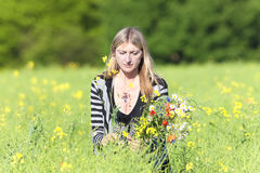 Woman Picking Wild Flowers on the Meadow Royalty Free Stock Image