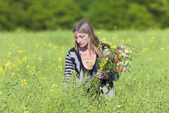 Woman Picking Wild Flowers on the Meadow Royalty Free Stock Photo