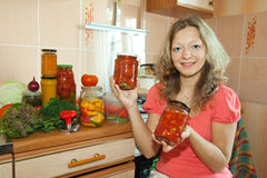 Woman with pickled vegetables Stock Photography