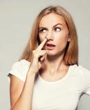 Woman picks his nose finger Stock Photos