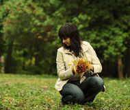 Woman picks up leaves Stock Image
