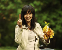 Woman picks up leaves Stock Photos