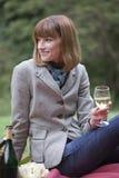 Woman by picnic Stock Photo