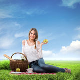 Woman on a picnic Stock Photos