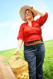 Woman with a picnic basket Royalty Free Stock Photos