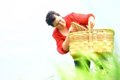 Woman with a picnic basket Stock Image