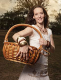 Woman with a picnic basket Royalty Free Stock Images