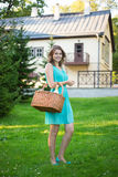 Woman with picnic basket and bottle of wine in park Stock Images