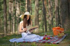 Woman on Picnic with Book Royalty Free Stock Image