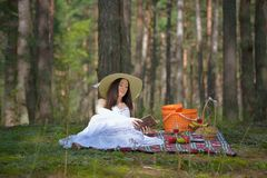 Woman on Picnic with Book Stock Image