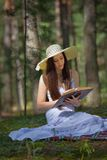 Woman on Picnic with Book Royalty Free Stock Photography