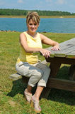 Woman at Picnic Table Stock Photo