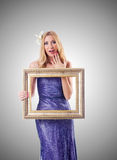 Woman with picture frame against gradient Royalty Free Stock Photography