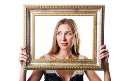 Woman with picture frames Stock Images