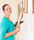 Woman with picture and hammer Royalty Free Stock Images
