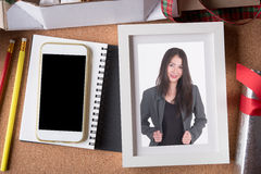 Woman picture in picture frame and blank smart phone and holiday Stock Images