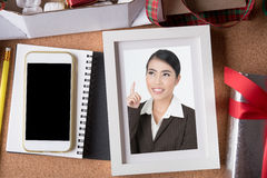 Woman picture in picture frame and blank smart phone and holiday Stock Photo