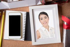 Woman picture in picture frame and blank smart phone and holiday Royalty Free Stock Photo