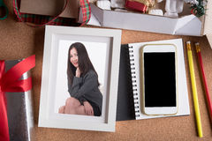 Woman picture in picture frame and blank smart phone and holiday Royalty Free Stock Image