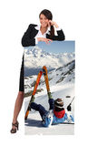 Woman with picture of skier Royalty Free Stock Photos