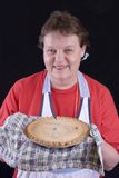 Woman with pie. Older woman holding a pie Stock Images
