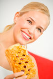 Woman with pie at home Stock Photo