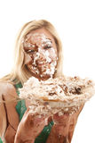 Woman with pie and messy face Royalty Free Stock Photography
