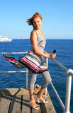 Woman on pier. Blonde woman on the pier at the sea Stock Photography