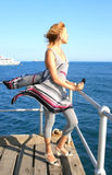 Woman in the pier. Blonde woman on the pier at the sea Stock Image