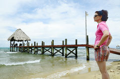 Woman by a pier Royalty Free Stock Images