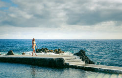 Woman on a pier at the ocean Royalty Free Stock Photos