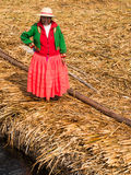 Woman on pier in Reed Islands on Lake Titicaca, 6/13/13 stock image