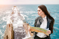 Woman on the pier watching map Royalty Free Stock Photography