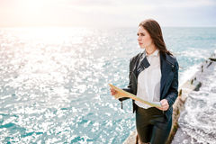 Woman on the pier watching map Royalty Free Stock Photos