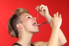 Woman piercing the tongue herself Royalty Free Stock Photo