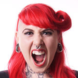 Woman with piercings screaming. Young woman with facial piercings screaming royalty free stock photos