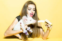 Woman with pig and banana Stock Photo