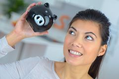 Woman with pig coin bank Stock Images