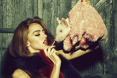 Woman with pig and lipstick royalty free stock photos