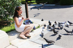 Woman and Pigeon in Athens Royalty Free Stock Photos