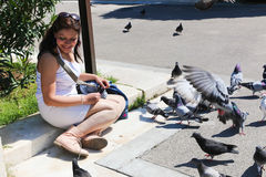 Woman and Pigeon in Athens Stock Photography